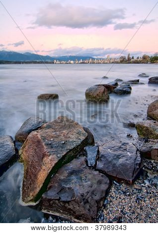 Rocks Large In Foreground With Vancouver Skyline