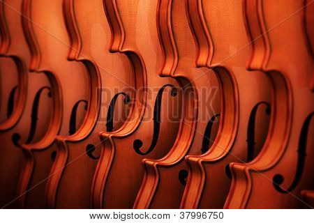 Violins in a Row