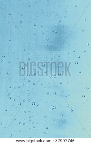 Textura abstrata: Gotas de água sobre fundo azul