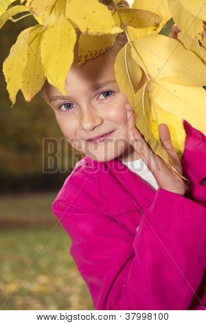 girl playing hide-and-seek outdoor in park