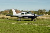 stock photo of ultralight  - Image of small plane with building at background - JPG