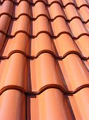 foto of red roof tile  - Roof made of red adobe tiles  - JPG