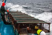 pic of lobster boat  - Traps lined up on the side of a lobster boat - JPG