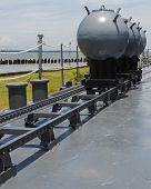 stock photo of battleship  - Naval mines were set on the rail at the deck of battleship - JPG