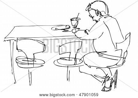 being fellow at a table on a chair in a cafe