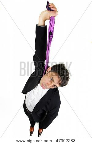Humorous high angle portrait of a businessman committing suicide holding up his tie as thoughit were a hangmans rope and dangling his head with his tongue protruding, isolated on white