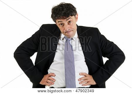 Businessman emphasizing a point standing with his hands akimbo on his hips and head lowered glaring with raised eyebrows, isolated on white