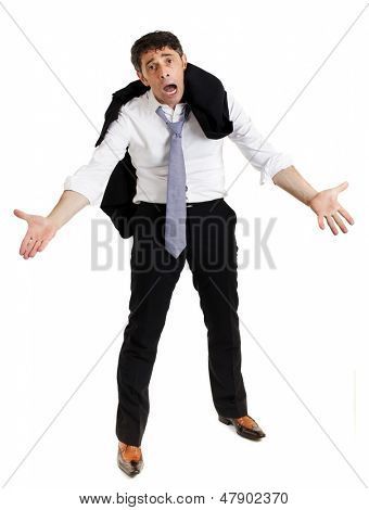 Despairing businessman standing with hunched shoulders, outstretched imploring hands and an anguished expression, isolated on white