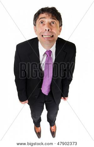 Desperate businessman shot from above, isolated on white