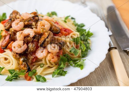 Pasta With Seafoods And White Wine On Napkin