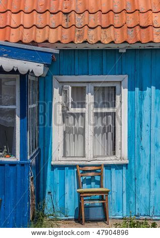 Window And Chair Of A House In Nida