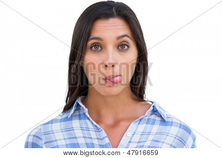 Silly woman with tongue out looking at camera on white background
