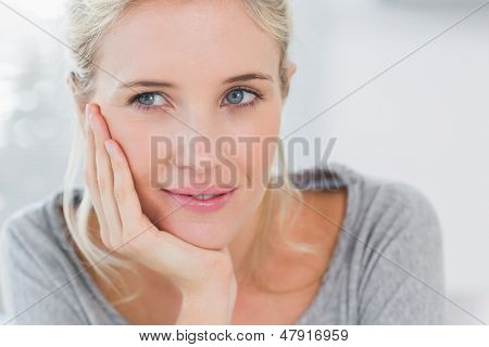Atrractive blonde woman thinking and looking away