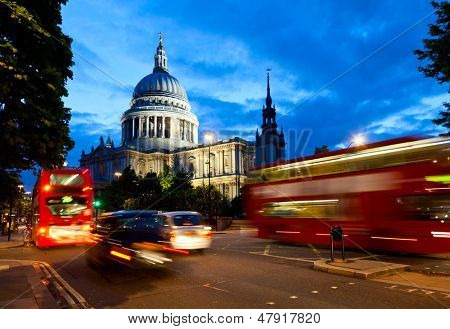 London cityscape with St Paul's Cathedral and moving Double Decker buses at night