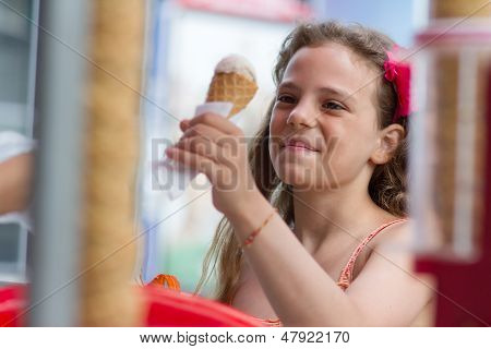 Little Girl Buying An Ice Cream
