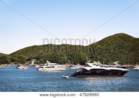 Luxury Boats Anchored In A Bay Off Hong Kong Island