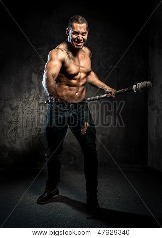 Muscular Man Holding Torch