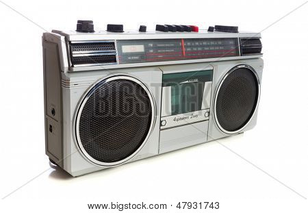 An old, vintage retro style silver boom box or radio cassette tape player