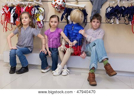 MOSCOW - MAR 18: Anya 7 years old, Jeanette 6 years old and Dmitry 10 years old sitting together with mannequins in the store children clothes Jakimanka on March 18, 2012 in Moscow, Russia.