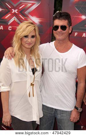 LOS ANGELES - JUL 11:  Demi Lovato, Simon Cowell at the