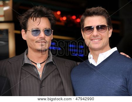LOS ANGELES - JUN 23:  Johnny Depp &Tom Cruise arrives to the Walk of Fame Honors Jerry Bruckheimer  on June 23, 2013 in Hollywood, CA
