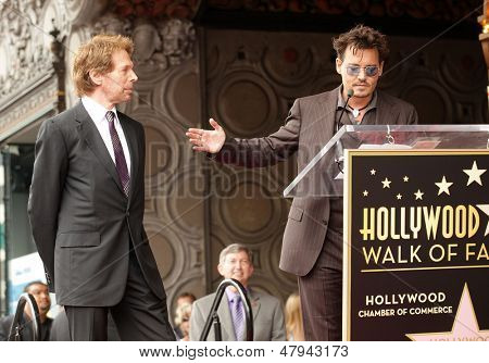 LOS ANGELES - JUN 23:  Johnny Depp & Jerry Bruckheimer arrives to the Walk of Fame Honors Jerry Bruckheimer  on June 23, 2013 in Hollywood, CA
