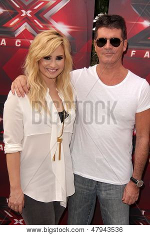 LOS ANGELES - JUL 11:  Demi Lovato, Simon Cowell at the