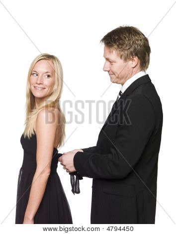 Man helping woman to get dressed