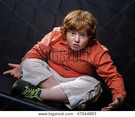 Freckled Red-hair Boy Posing On Dark Background.