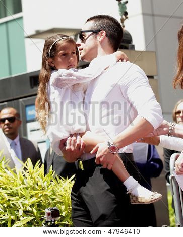 LOS ANGELES - JUN 19:  Casper Smart and Emme arrives to the Walk of Fame Honors Jennifer Lopez  on June 19,2013 in Hollywoods, CA