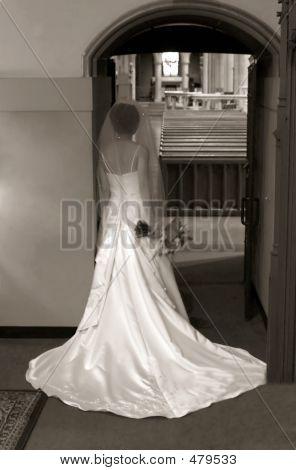 Bride Looking Into Church Sepia