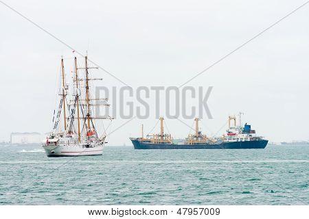Sailing Vessel And Modern Oil Tanker Ship