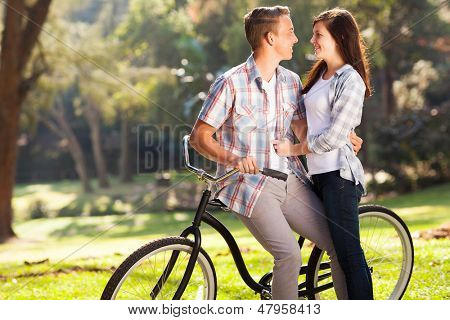 lovely happy teenage couple hugging outdoors