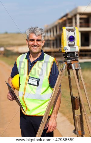 happy senior land surveyor portrait outdoors