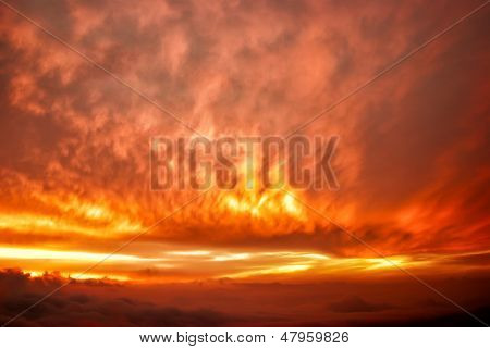 wee red clouds on the sky. clouds in the light of the setting sun. clouds at dawn