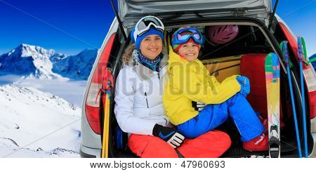 Winter, skiing, journey - family with ski equipment ready for travel to ski resort