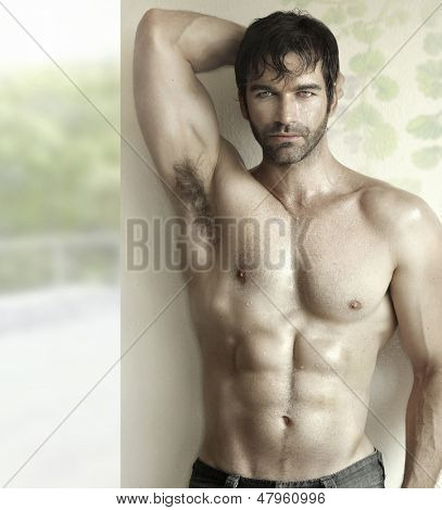 Inspiring sensual portrait of a sexy male fitness model