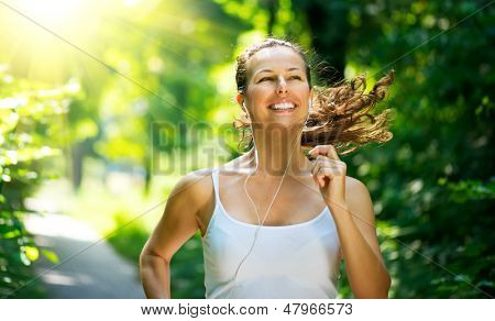 Running woman. Female Runner Jogging during Outdoor Workout in a Park. Beautiful fit Girl. Fitness model outdoors. Weight Loss