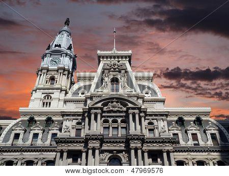 Philadelphia's landmark historic City Hall building with sunset sky.