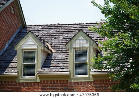Two Dormers On Brick Homes With Wood Shingles