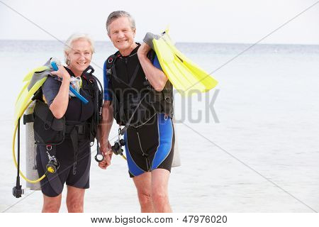 Senior Couple With Scuba Diving Equipment Enjoying Holiday