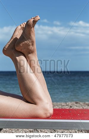 Barefeet On A Summer Background