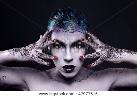 Extreme Make Up Cosmetics on a Beautiful Woman