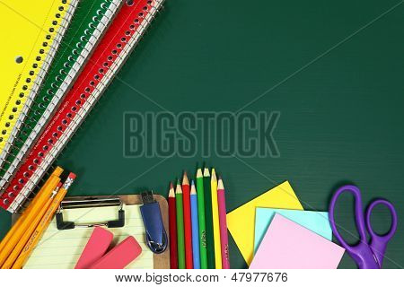 Miscellaneous Back to School Items on a Chalkboard Background