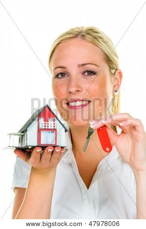 a broker for real estate with a house and a key. successful leasing and property for sale by real estate agents.