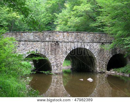 Fieldstone Bridge Over Summer Stream