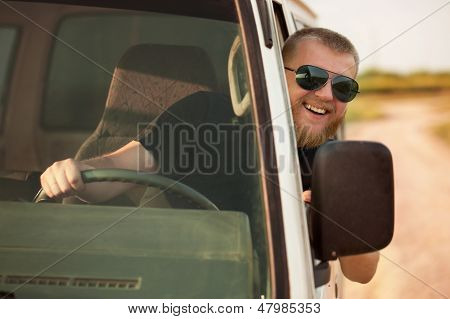 Cheerful Driver Behind The Wheel Of His Car