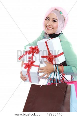 Happy Young Muslim Woman With Shopping Bag And Gift Boxes