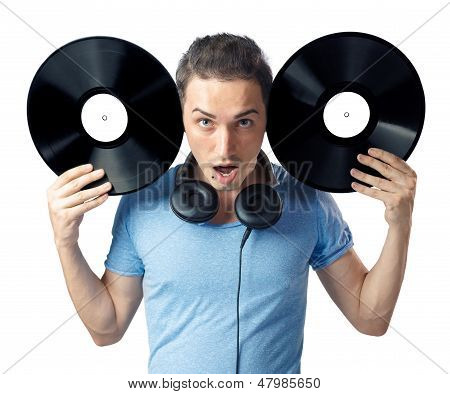 Young Man Posing To Camera With Two Black Vinyls