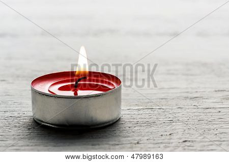 Single Burning Red Tealight Candle